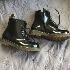 Girl's Dr Martens boots.